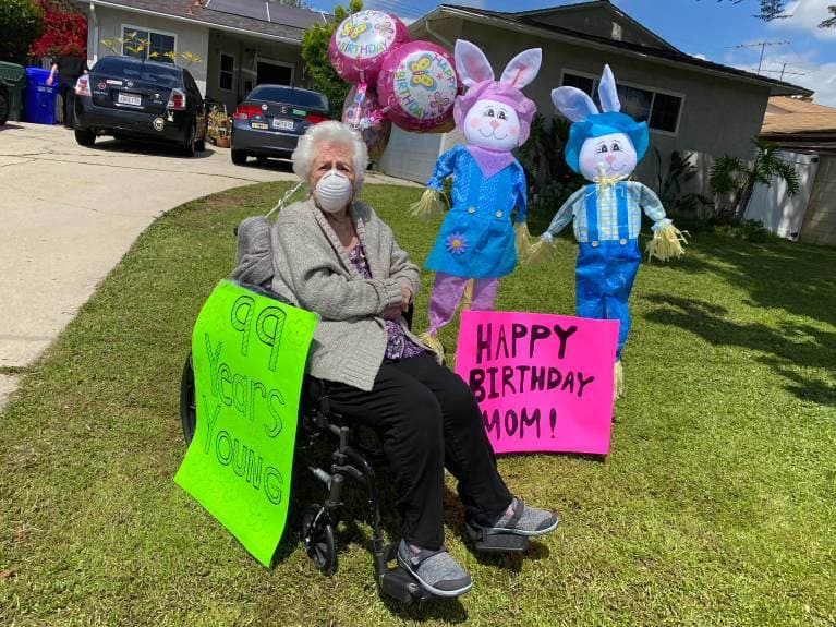 A woman celebrates her birthday with a drive-by party.